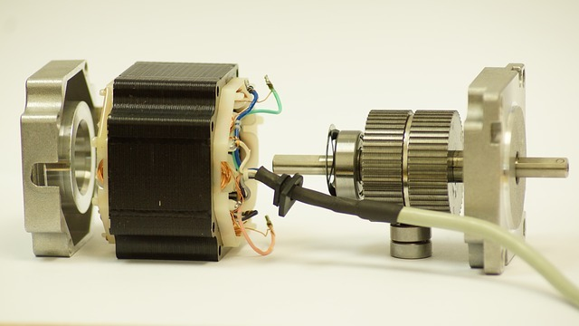 A close-up image of a disassembled stepper motor showing its parts, including the stator, rotor, and coil.