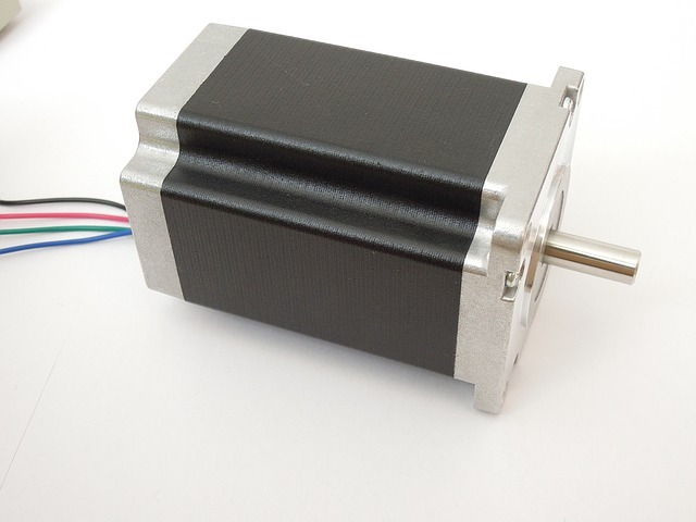A hybrid stepper motor with four connection cables at the back.